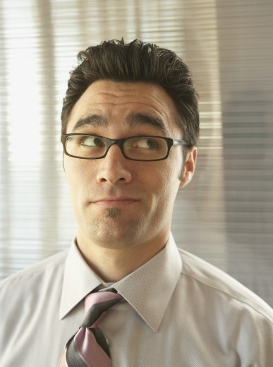 Stock Photo: 1589R-17364 Skeptical businessman rolling his eyes