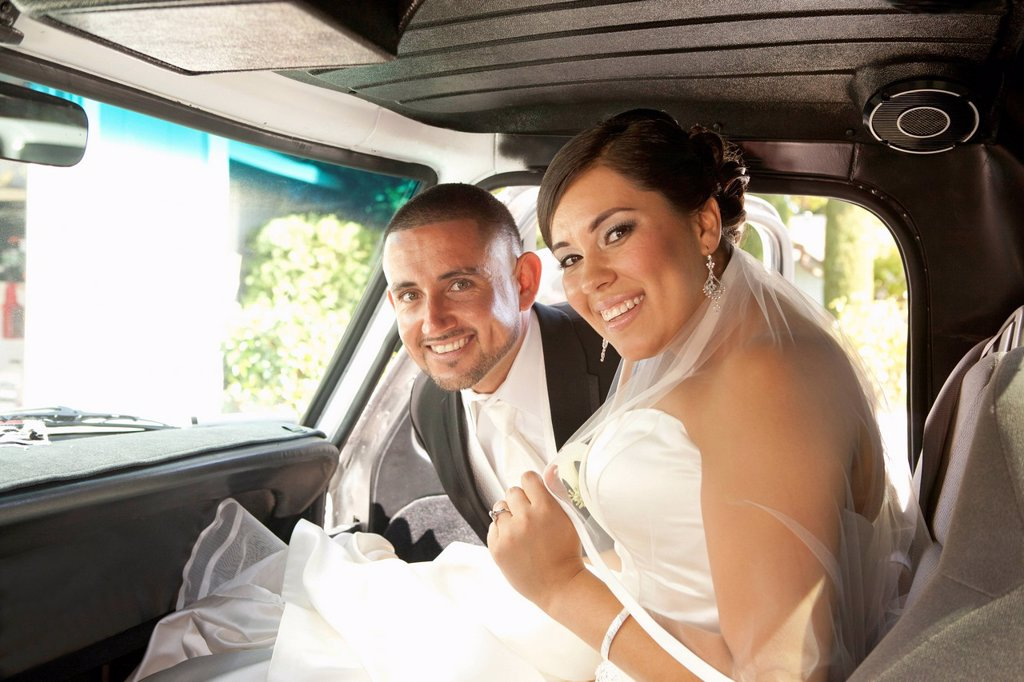 Stock Photo: 1589R-174883 Hispanic bride and groom in truck