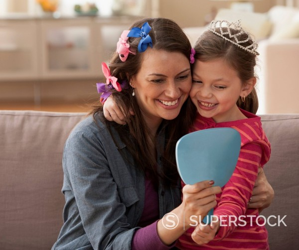 Stock Photo: 1589R-175625 Caucasian mother and daughter playing dress up