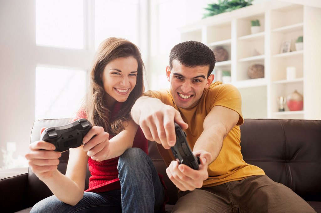 Stock Photo: 1589R-175745 Couple playing video games together