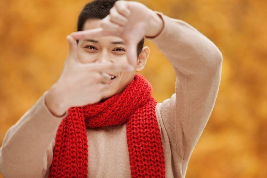 Stock Photo: 1589R-178081 Chinese man making framing gesture