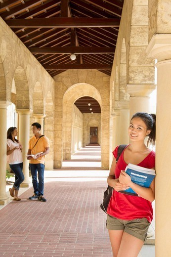 Chinese student smiling on campus : Stock Photo