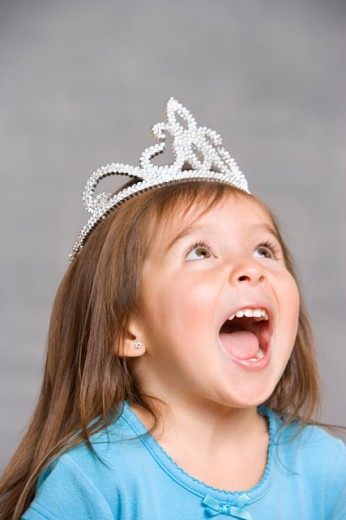 Stock Photo: 1589R-18732 Close up of young girl wearing princess crown and looking up
