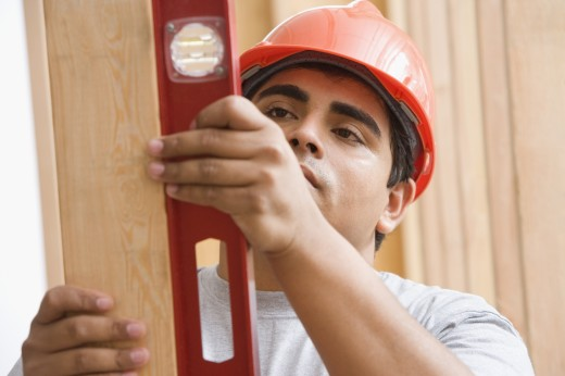 Stock Photo: 1589R-18784 Construction worker with level