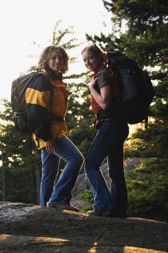 Stock Photo: 1589R-19830 Friends hiking on rocky terrain