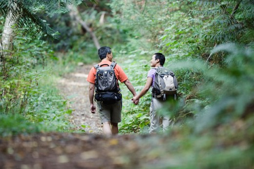 Rear view of couple hiking on trail : Stock Photo