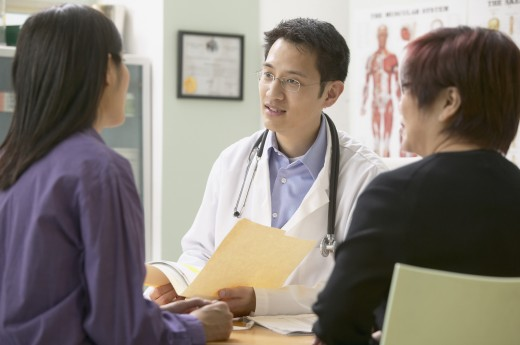 Stock Photo: 1589R-20321 Male doctor talking with patient