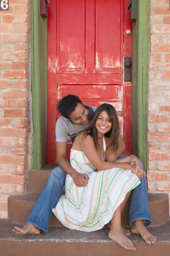 Stock Photo: 1589R-20943 Couple hanging out on a doorstep