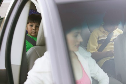 Family riding in a car : Stock Photo