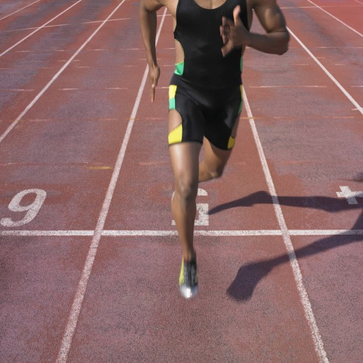 Stock Photo: 1589R-23167 African male athlete running on track, Perth, Australia