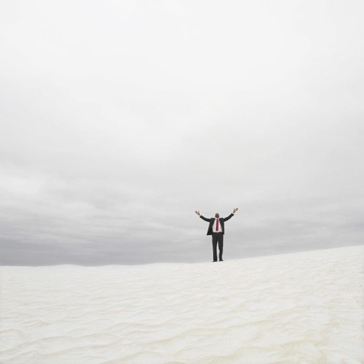 Stock Photo: 1589R-23321 Businessman in the desert with his arms outstretched, Lancelin, Australia