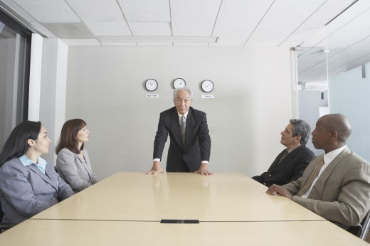 Stock Photo: 1589R-23482 Senior businessman presiding over meeting