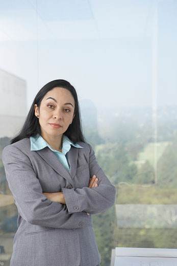 Stock Photo: 1589R-23531 Hispanic businesswoman next to window, Los Angeles, California, United States