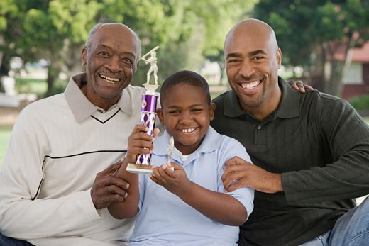 Stock Photo: 1589R-23617 African American family with trophy outdoors