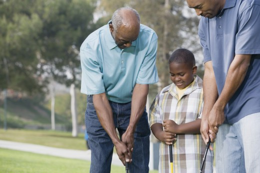 Stock Photo: 1589R-23624 African American family playing golf