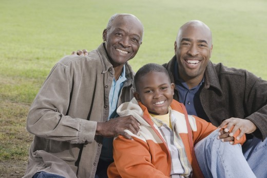 African American family smiling outdoors : Stock Photo