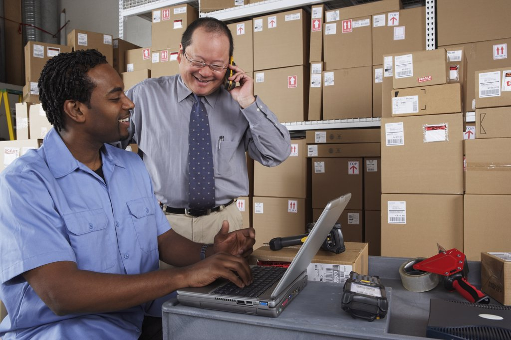 Stock Photo: 1589R-23748 Businessman and co-worker in shipping department