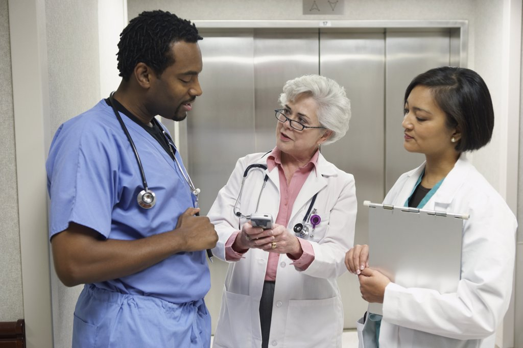Stock Photo: 1589R-23842 Hospital staff talking in front of elevator, Bethesda, Maryland, United States