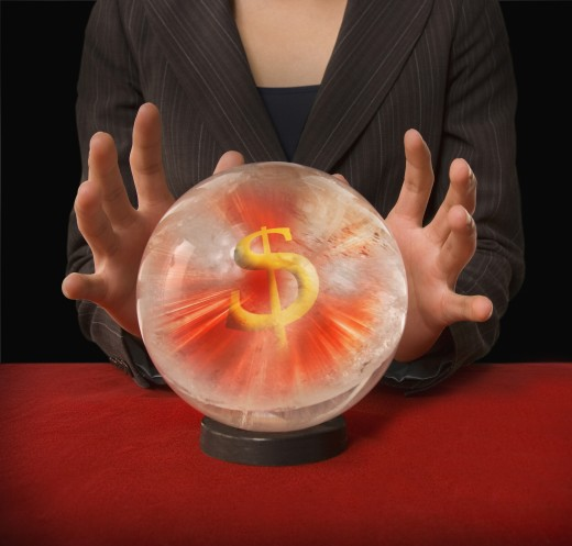 Businesswoman's hands around crystal ball with dollar sign in it : Stock Photo
