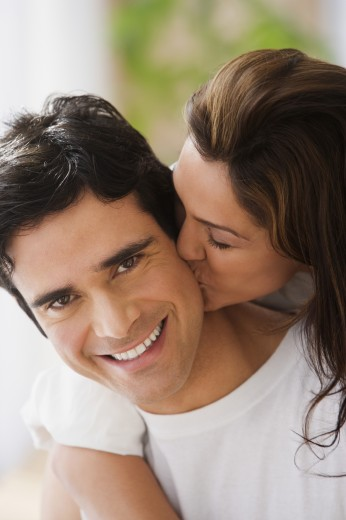 Stock Photo: 1589R-24566 Close up of couple hugging and kissing