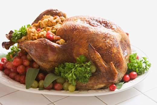 Roasted turkey on platter with dressing : Stock Photo