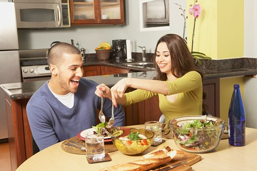 Young Hispanic couple at the dinner table, San Rafael, California, United States : Stock Photo