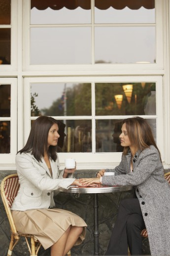 Two women talking over coffee at a cafe, Larkspur, California, United States : Stock Photo