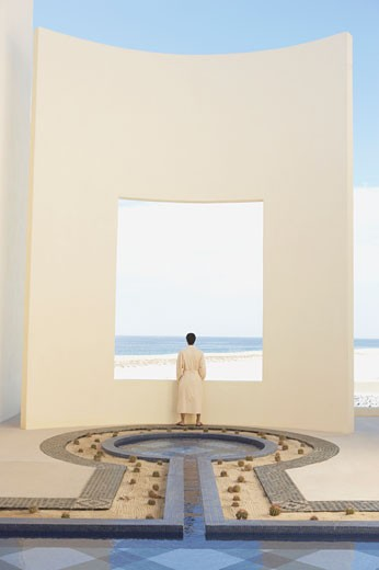Person in robe at beach resort, Los Cabos, Mexico : Stock Photo