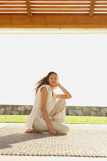 Hispanic woman sitting outdoors, Los Cabos, Mexico : Stock Photo