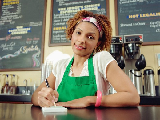 Stock Photo: 1589R-25701 Waitress taking order in coffee shop