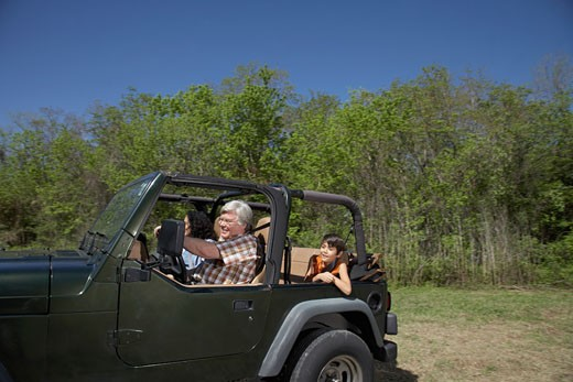 Stock Photo: 1589R-25877 Hispanic family riding in jeep
