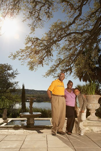 Stock Photo: 1589R-25889 African American family hugging outdoors