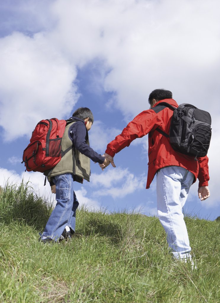 Stock Photo: 1589R-25911 Asian father and son backpacking
