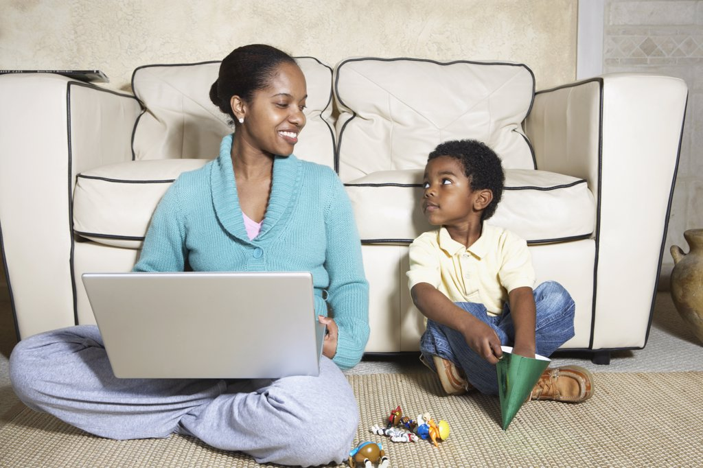 Stock Photo: 1589R-25931 African American mother sitting with son and laptop