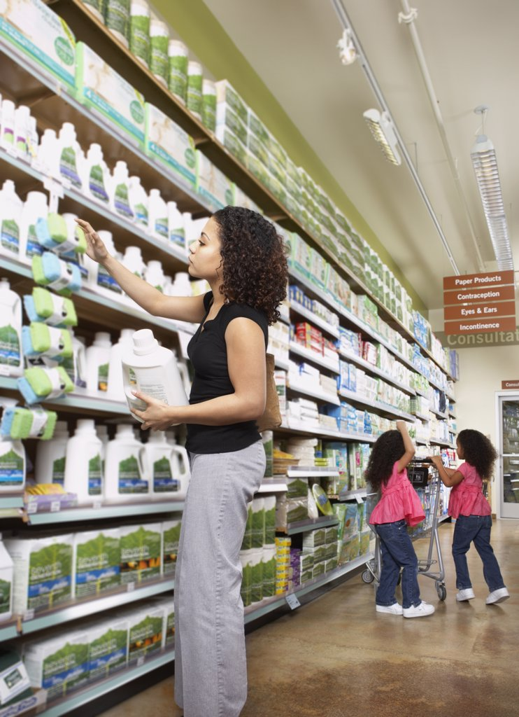 Stock Photo: 1589R-25951 Mother with young daughters in grocery store