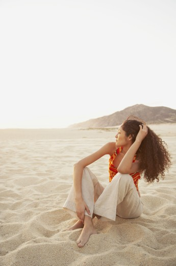 Stock Photo: 1589R-26028 Hispanic woman on the beach, Los Cabos, Mexico
