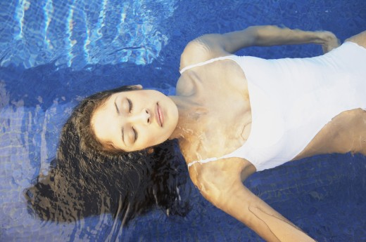 Stock Photo: 1589R-26053 Hispanic woman floating in pool