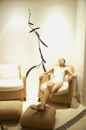 Woman relaxing in spa room : Stock Photo