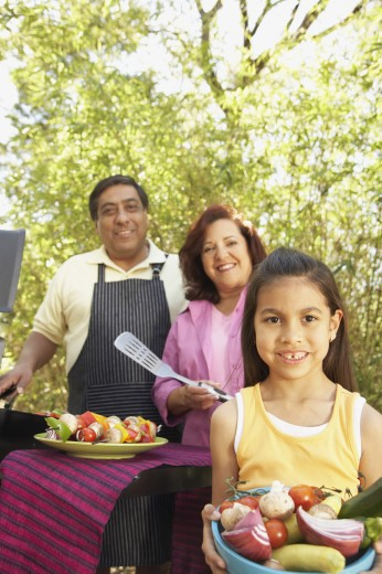 Stock Photo: 1589R-26126 Hispanic family using barbecue grill