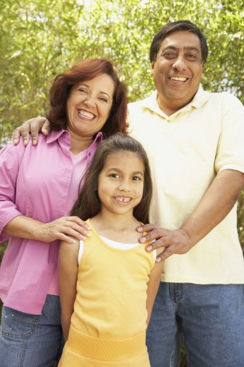 Stock Photo: 1589R-26136 Hispanic family smiling outdoors