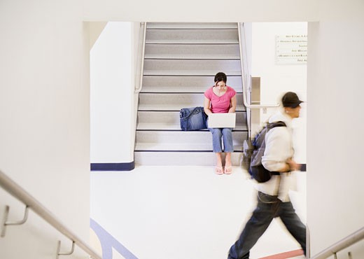 Stock Photo: 1589R-26365 Female student with laptop on stairs