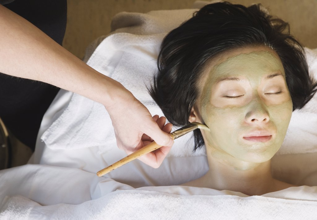 Asian woman receiving spa facial treatment : Stock Photo