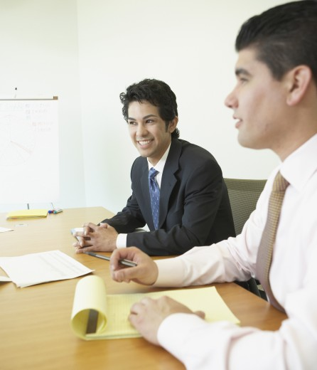 Stock Photo: 1589R-26873 Businessmen at meeting