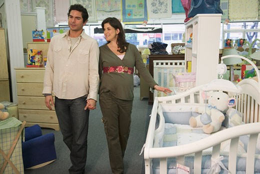 Stock Photo: 1589R-27255 Pregnant couple shopping for baby furniture