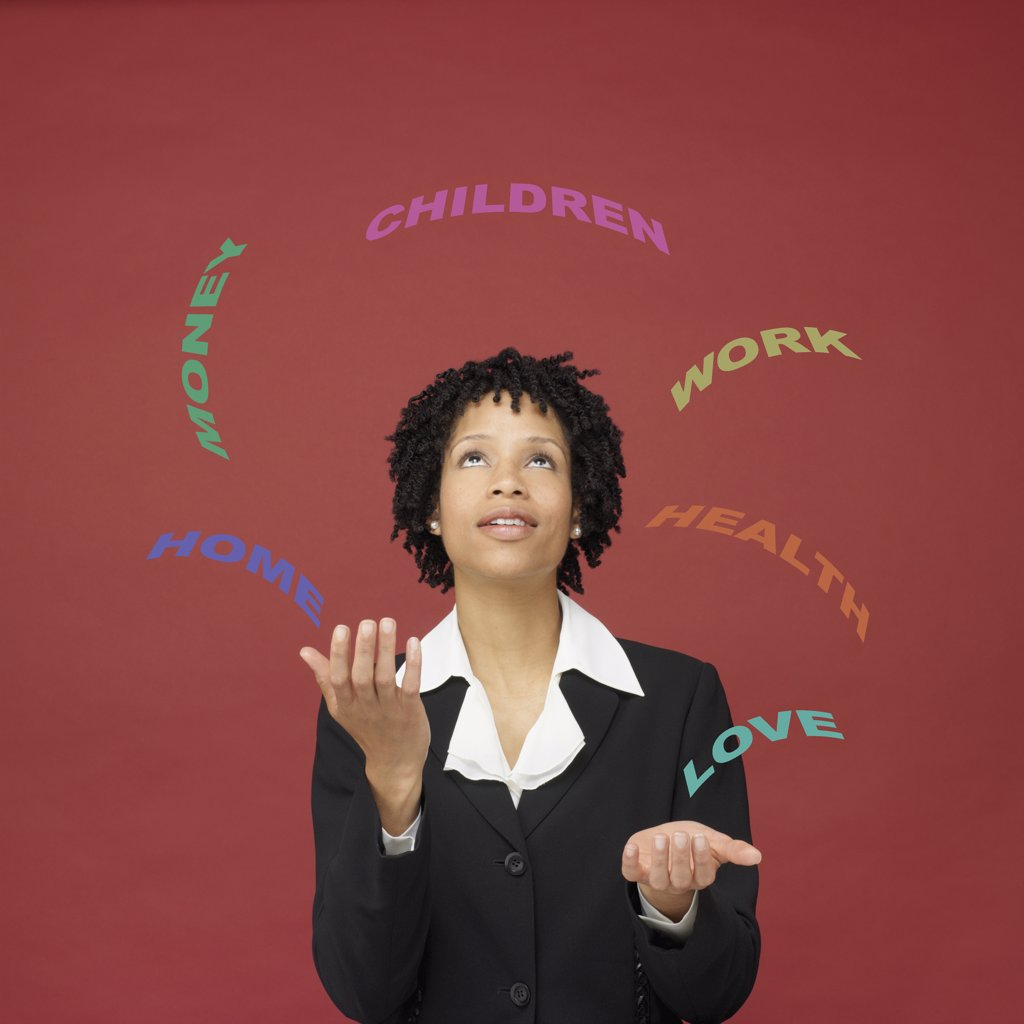 African businesswoman juggling words representing busy life : Stock Photo