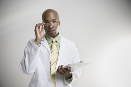Stock Photo: 1589R-27494 African male doctor with chart