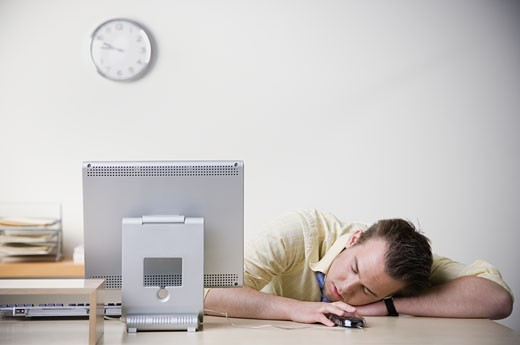 Stock Photo: 1589R-27515 Businessman sleeping on desk