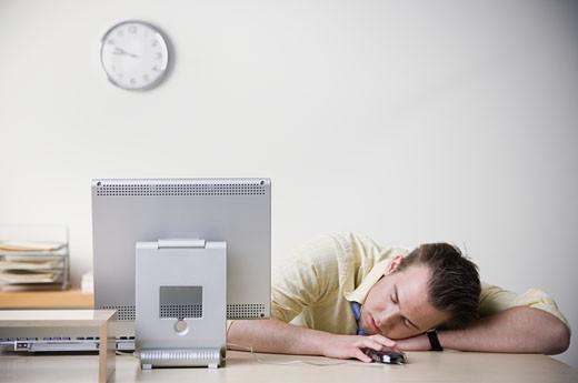 Businessman sleeping on desk : Stock Photo