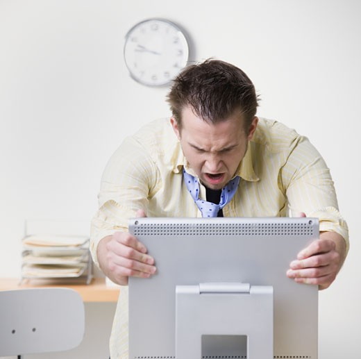 Stock Photo: 1589R-27516 Businessman grabbing computer and yelling