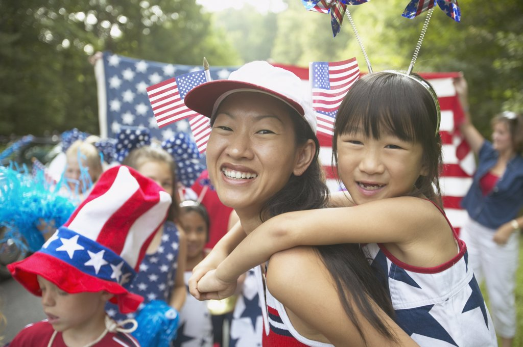 Stock Photo: 1589R-27692 Asian mother and daughter in Fourth of July parade